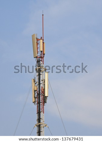 top part of communication  antenna in sunny day - stock photo