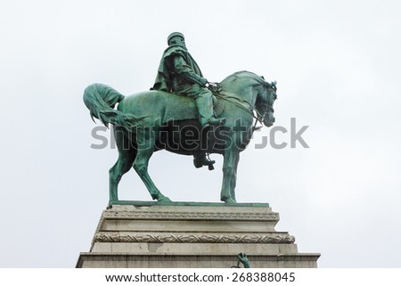 Top part of statue Garibaldi on horse in Milan from left side - stock photo