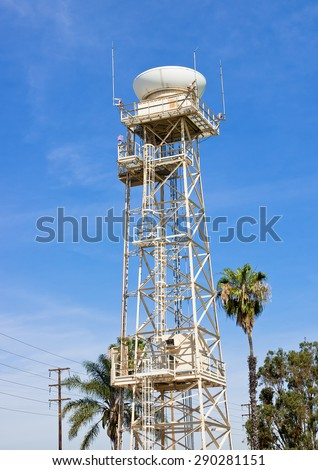 Top part of the radar tower spins rapidly for electronic communications. - stock photo