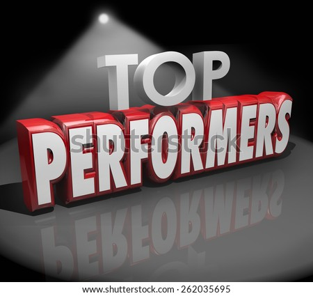 Top Performers words in 3d red letters on stage under a spotlight to illustrate or recognize best workers, artists or people doing a great job - stock photo