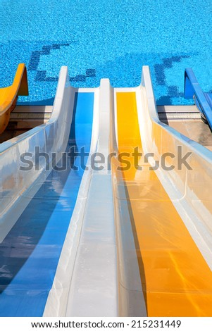 top point of view of water slide with pool - stock photo