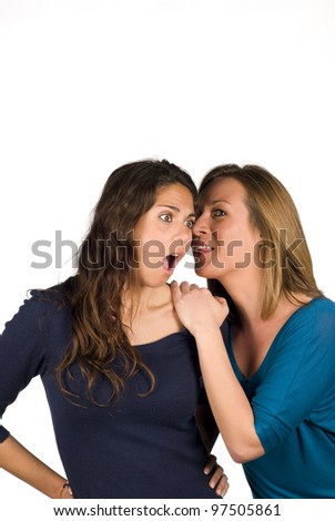 Top secret being whispered from ear to ear - stock photo