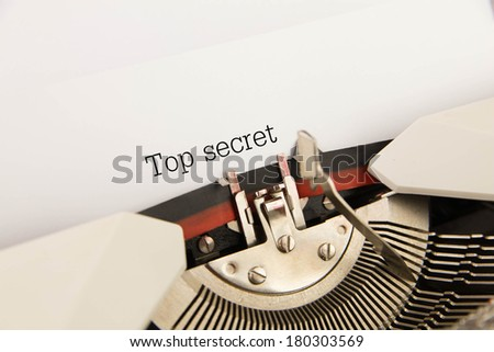 Top secret  printed on a clean sheet to the typewriter - stock photo