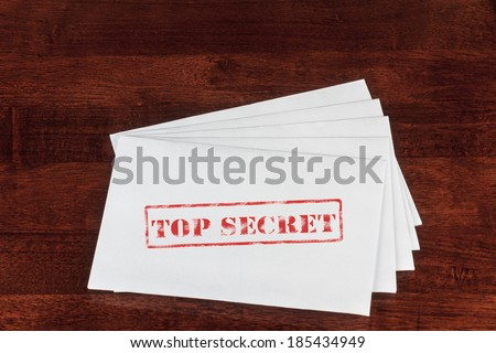 Top Secret Rubber Stamp on a White Envelope - stock photo