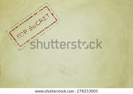 Top secret rubber stamp on an old piece of paper - stock photo