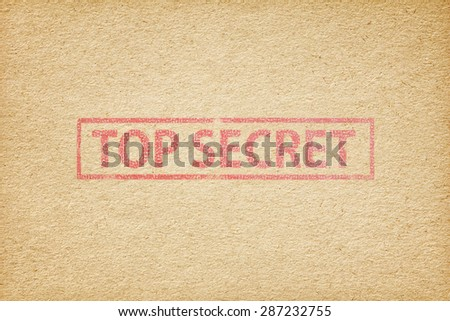 Top secret stamp on the brown paper background - stock photo