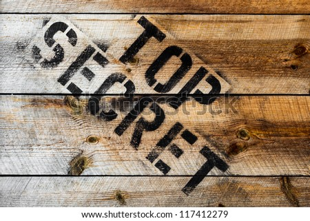 Top Secret stamp on wooden background or wooden box - stock photo