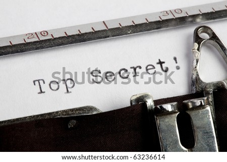 Top Secret written on an old typewriter - stock photo