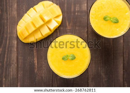 Top shot mango smoothie on wooden table - stock photo