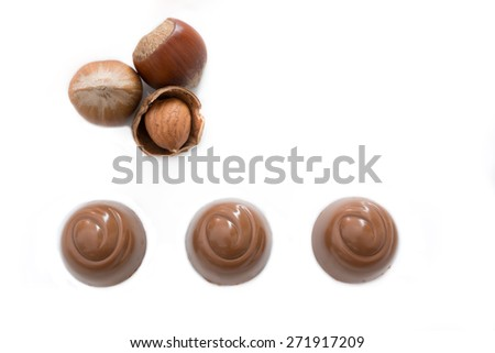 Top vies of chocolate pralines isolated on white background - stock photo