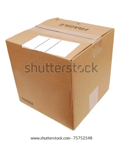 Top view: A shipping box with white label - stock photo