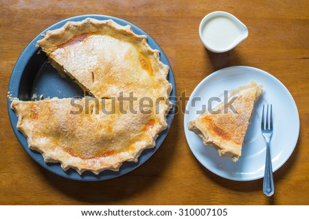Top view, Apple pie and a piece of apple pie on a wooden table. - stock photo