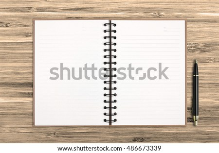 top view blank recycle notebook or diary with pen on chic wood table for your text