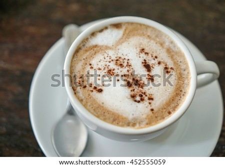Top view cappuccino coffee on wood table background