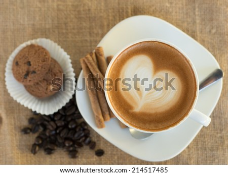 Top view Cappuccino or latte coffee with heart shape - stock photo