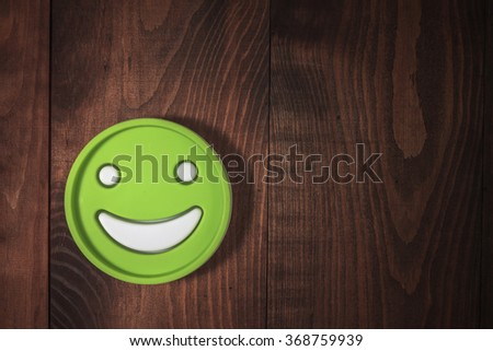 Top view, closeup. Smile on a wooden background. Concept: happiness. Free space for text