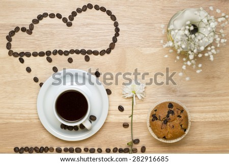 Top view coffee,muffins and applications from coffe beans - stock photo