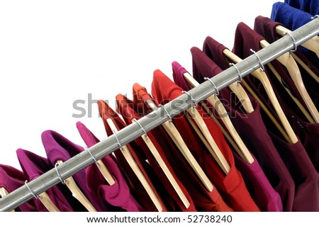 Top view colored Tee Shirts hanging - stock photo