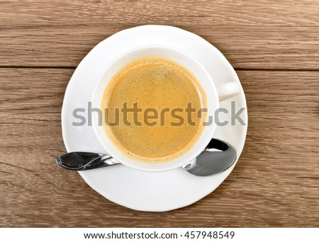 Top view Cup of coffee in a white cup on wooden background - stock photo