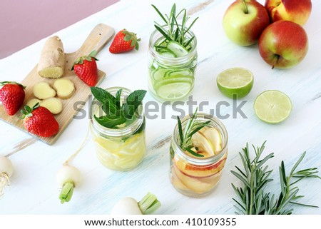 top view Detox fruit infused flavored water. Refreshing summer homemade cocktail - stock photo
