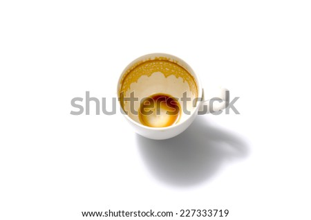 top view empty and dirty cup of coffee on a white background - stock photo