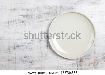 Top view empty plate on rustic wooden table - stock photo
