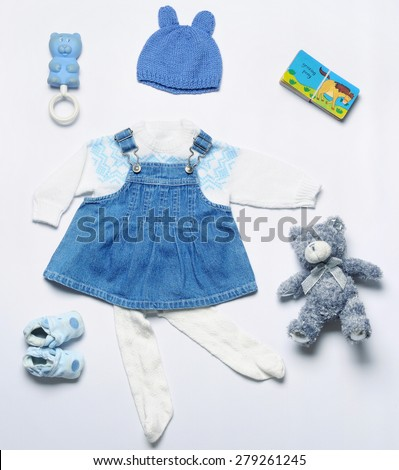 top view fashion trendy look of baby girl clothes and toy stuff, baby fashion concept  - stock photo