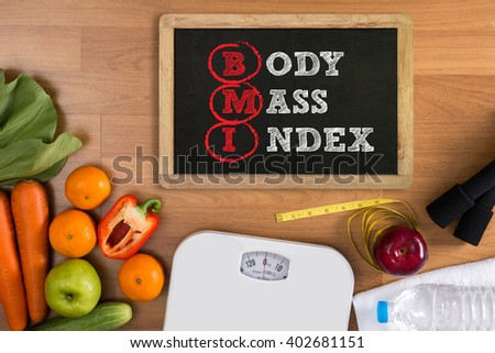 top view, fitness and weight loss concept, dumbbells, white scale, towels, fruit, BMI body mass index formula rate formula in a board - stock photo