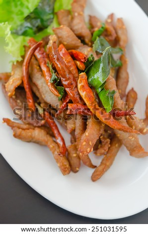 top view  fresh fried meat with sesame and chili - stock photo