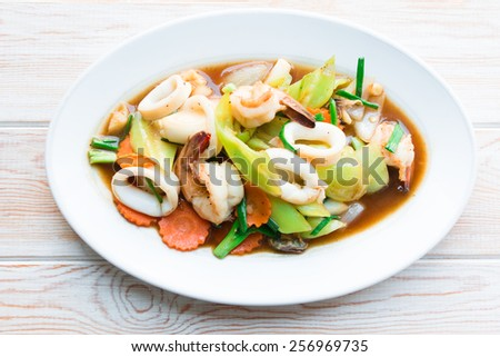 Top view - Fried mix seafood with oyster sauce and green pepper - stock photo