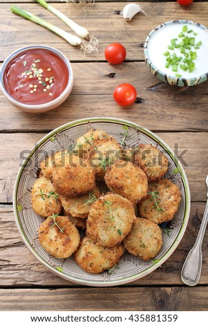 top view fried potatoes meatballs on kitchen table background - stock photo