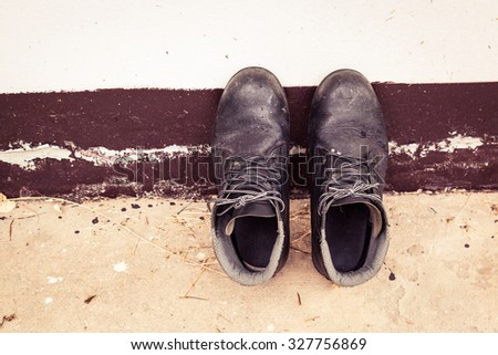 top view from pair of old boots - stock photo