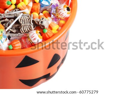 top view halloween pumpkin pail with candy - stock photo