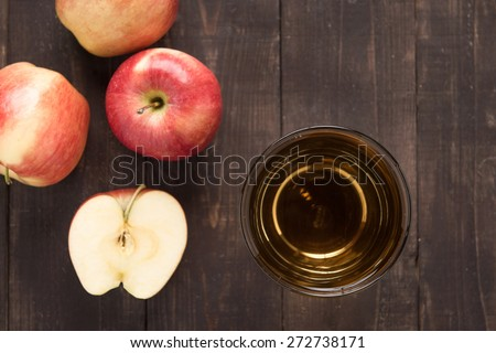 Top view healthy apple juice drink and red apples fruits on wooden background. - stock photo