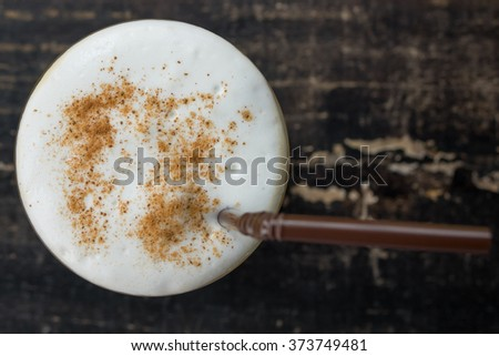 Top view Ice coffee on a wooden table - stock photo