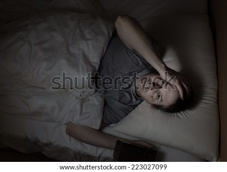 Top view image of mature man, looking forward, having trouble sleeping from insomnia - stock photo
