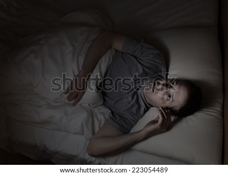 Top view image of mature man restless in bed from insomnia - stock photo