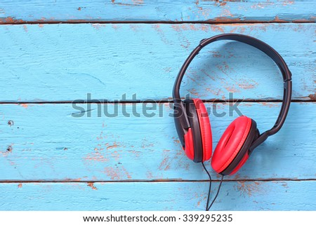 top view image of retro headphones over wooden textured background - stock photo