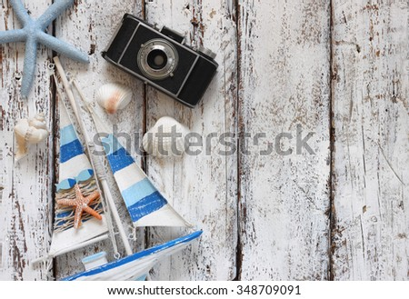 top view image of wood boat, sea shells and star fish over wooden table  - stock photo