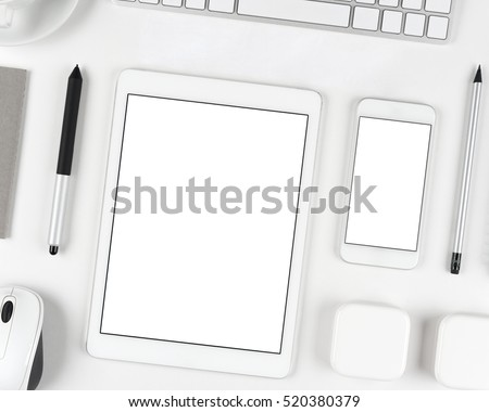 Top view: Keyboard tablet and smartphone on white table background with text space and copy space