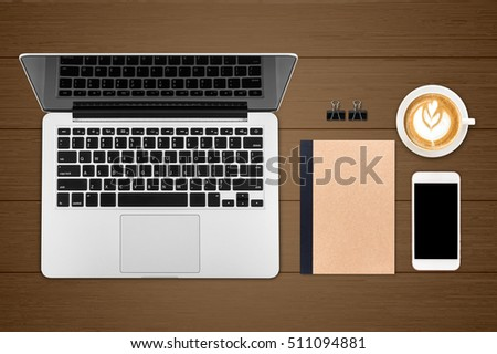 Top view laptop computer with cup of coffee and smartphone and diary or note book on office desk table.Business template mock up for adding your text.