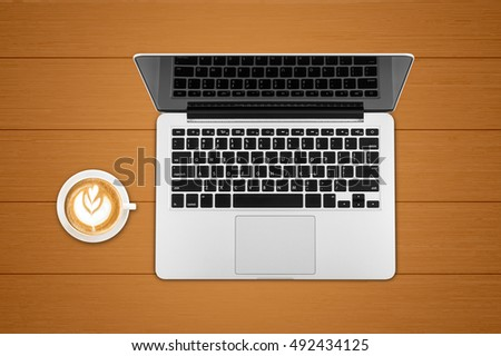 Top view laptop computer with mobile phone, cup of coffee, tablet, on office desk table.Business template mock up for adding your text.