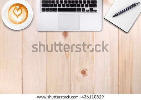 Top view laptop or notebook workspace office and latte coffee on wood table - stock photo