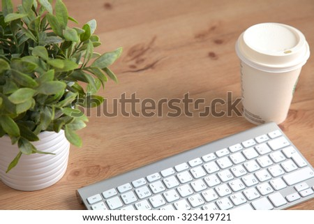 Top view laptop or notebook workspace office on wood table - stock photo