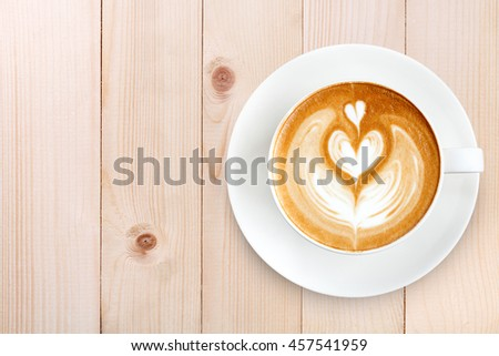 Top view latte art coffee on wood background - stock photo