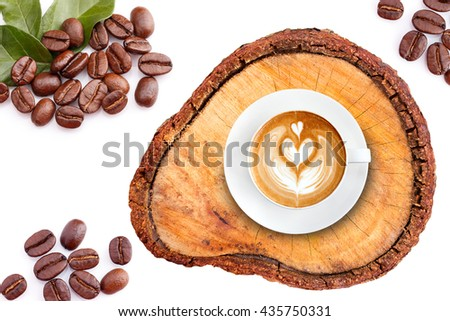 Top view latte art coffee on wood with roasted coffee beans - stock photo