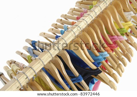 Top view line of multi colored shirts on hangers