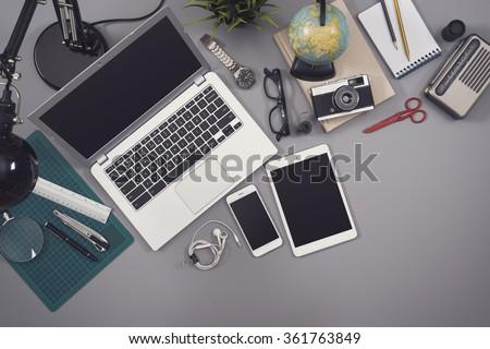 Top view messy desk responsive design mockup - stock photo