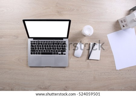 Top view mock up screen laptop with note book and coffee cup on wooden desk