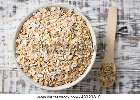 Top view, oat, bran and macadamia corn flake breakfast cereal, bran cereal with flax seeds - stock photo